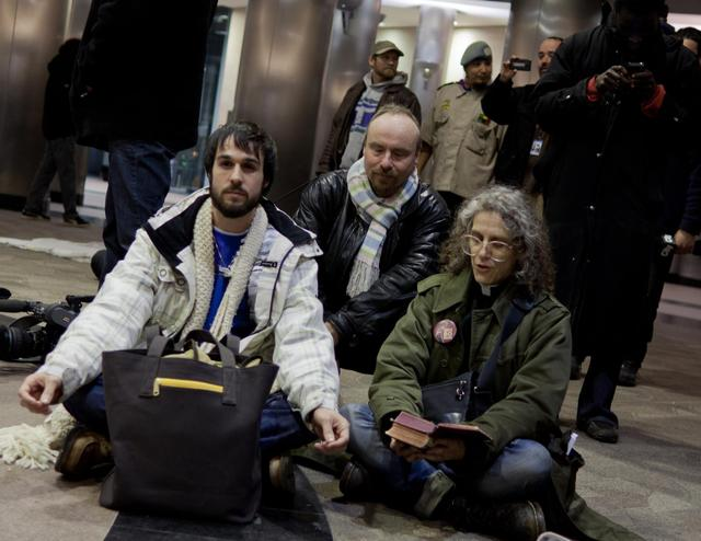 Evening prayer during a sit-in at Metro Hall, asking for an emergency cold shelter